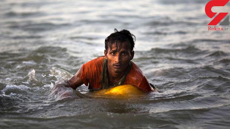 4 کیلومتر شنا برای فرار از زنده زنده در آتش سوزانده شدن! + عکس های دردناک