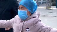 ویدیوی تلخ از ملاقات خانم پرستار چینی با دخترش / کرونا را باید بکشم