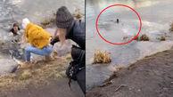 فداکاری زن جوان برای نجات یک سگ از رودخانه + فیلم