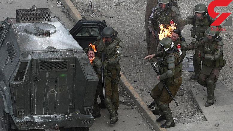لحظه آتش گرفتن 2 خانم پلیس + عکس وحشتناک / شیلی