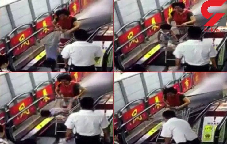 فیلم سقوط دختربچه از سبد خرید فروشگاه/ چرخ سبد خرید در پله برقی گیر کرد