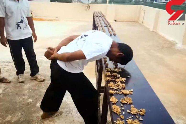 مرد هندی رکورددار شکستن گردو با پیشانی +تصاویر