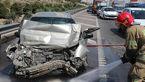 گرفتار شدن راننده در خودروی سواری له شده در آزادگان تهران + عکس