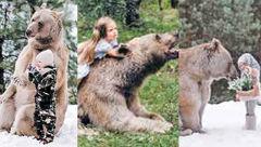 این دخترزیبای روس دوست وحشی ترین خرس جهان است + عکس های باورنکردنی
