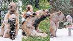 این دختر زیبای روس دوست وحشی ترین خرس جهان است + عکس های باورنکردنی